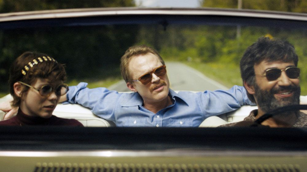 """Sophia Lillis, Paul Bettany and Peter Macdissi in """"Uncle Frank."""""""