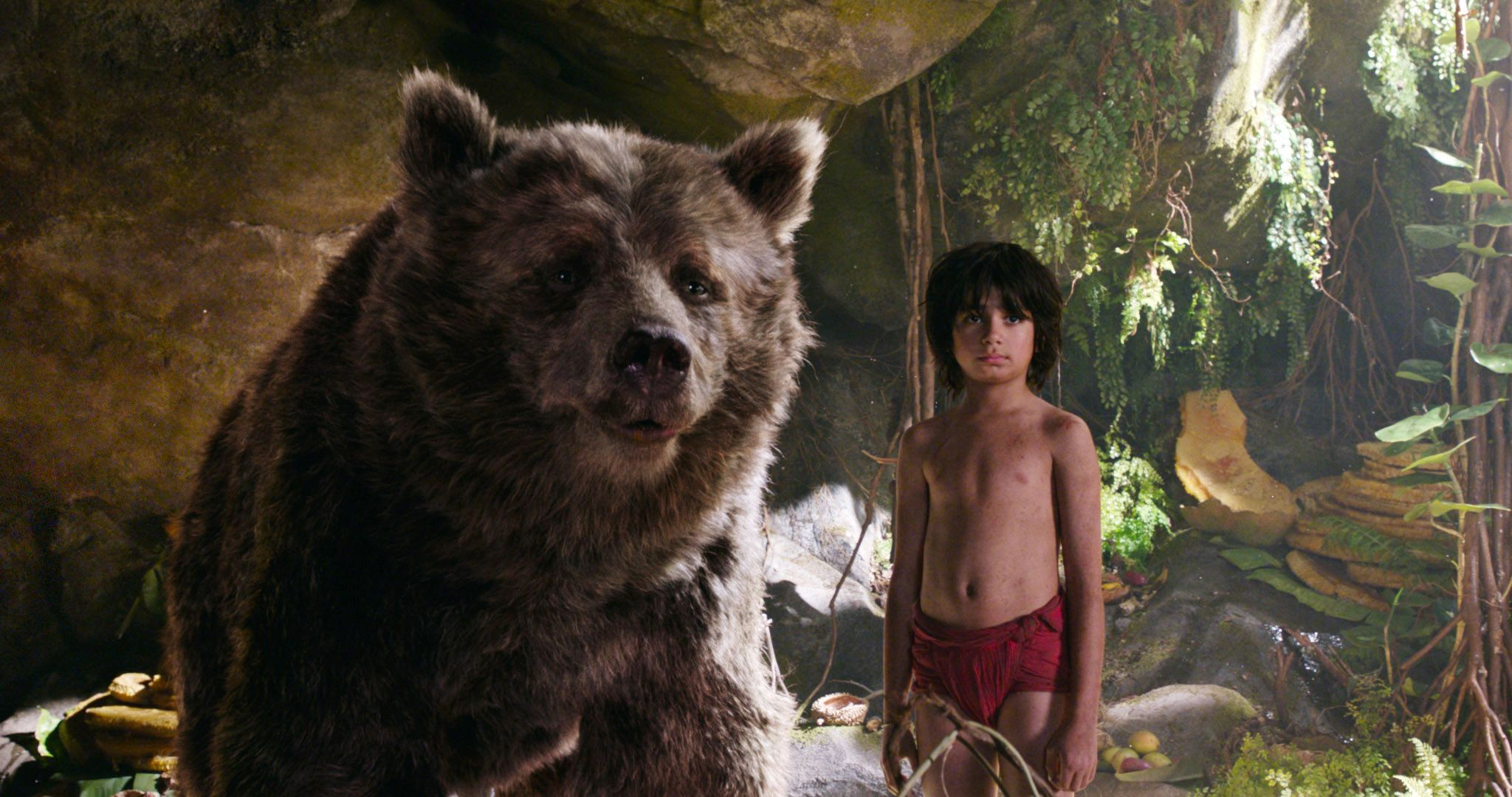 """Baloo (voice: Bill Murray) and Neel Sethi in """"The Jungle Book (2016)."""""""