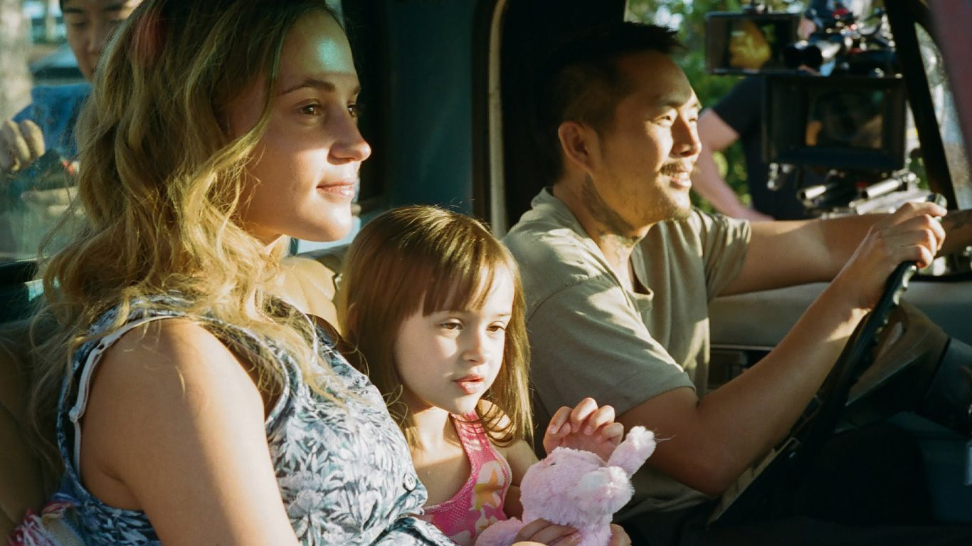 "Alicia Vikander, Sydney Kowalske, Justin Chon in ""Blue Bayou."""