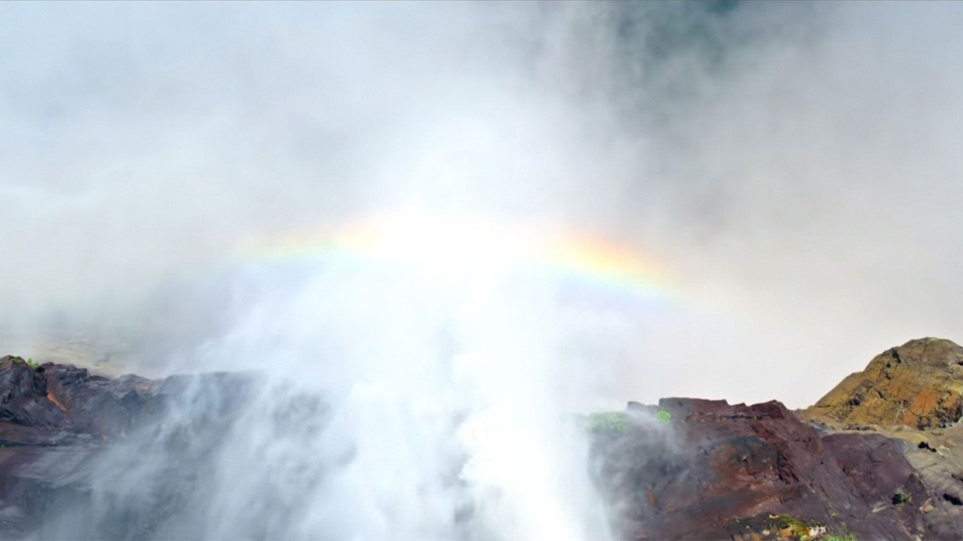 """A rainbow forms in a scene from """"Aquarela."""""""