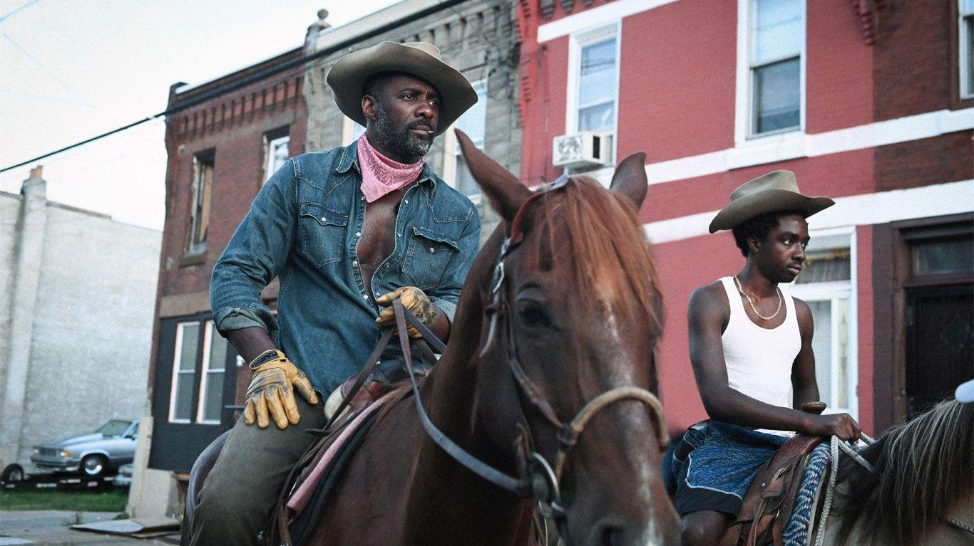 "Idris Elba and Caleb McLaughlin in ""Concrete Cowboys."""