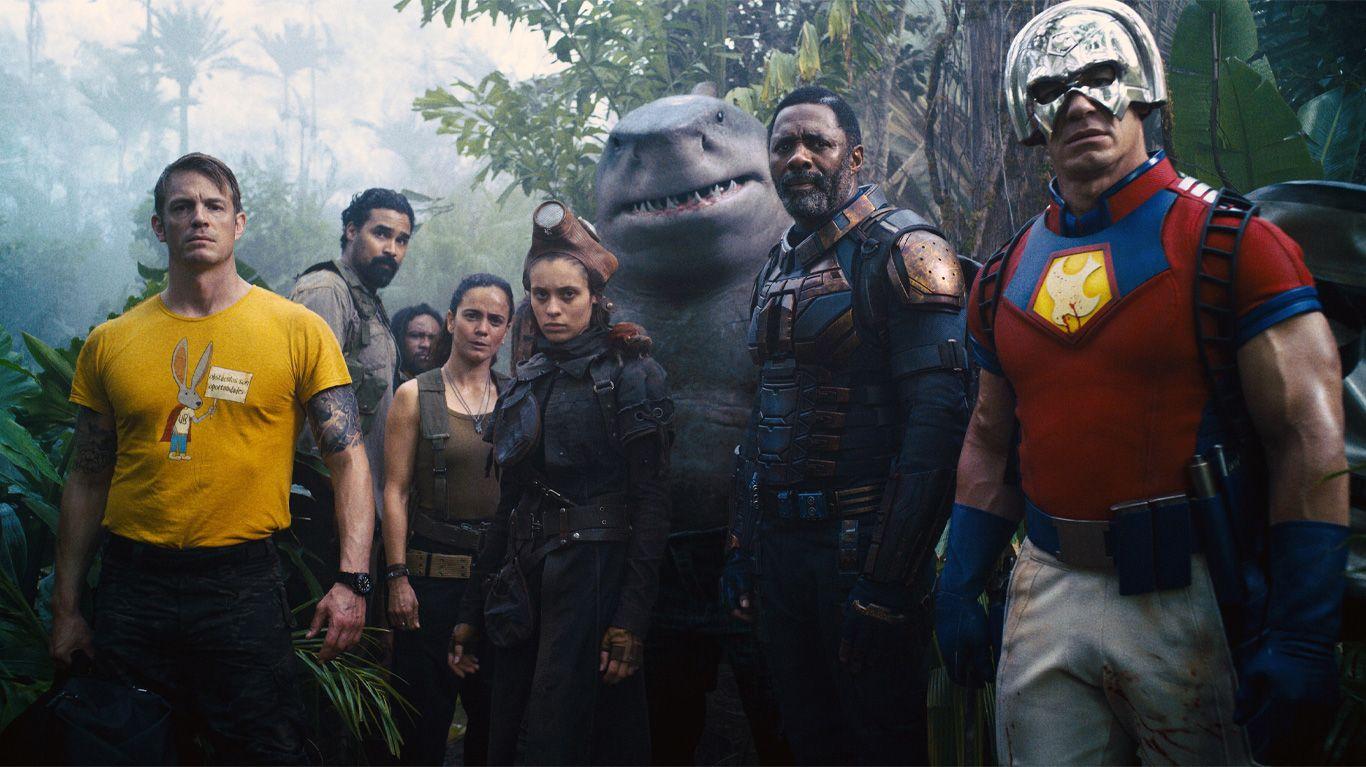 "Joel Kinnaman, Daniela Melchior, King Shark (voice: Sylvester Stallone), Idris Elba, and John Cena in ""The Suicide Squad."""