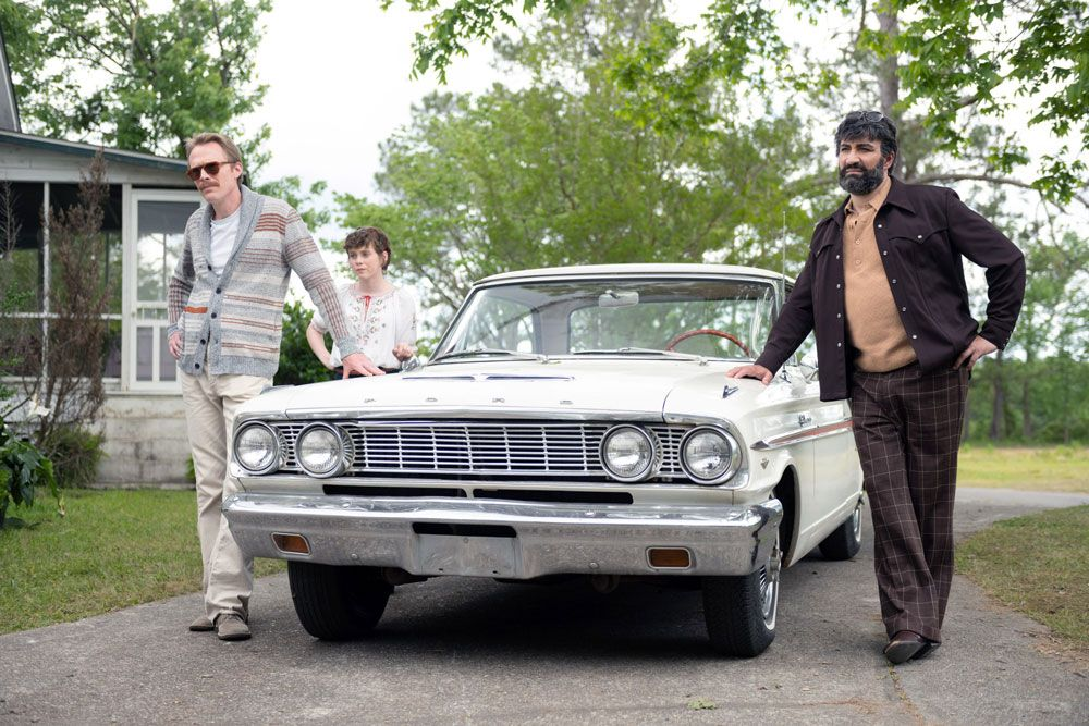 """Paul Bettany, Sophia Lillis, and Peter Macdissi in """"Uncle Frank."""" © Amazon / Courtesy Everett Collection"""