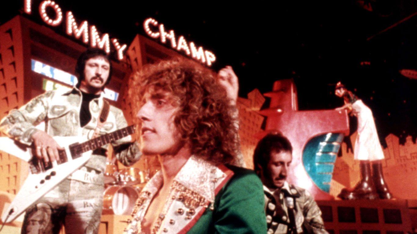 "John Entwistle, Roger Daltrey, Pete Townsend and Elton John in ""Tommy."""