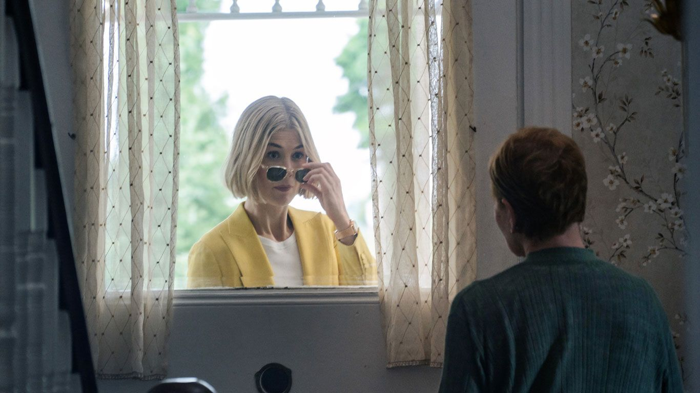 """Rosamund Pike and Dianne Wiest (back to camera) in """"I Care a Lot."""""""