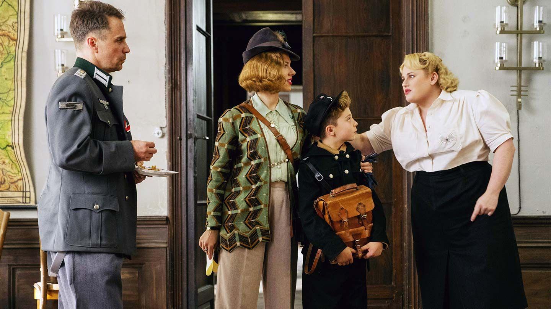 "Sam Rockwell, Scarlett Johansson, Roman Griffin Davis, and Rebel Wilson in ""Jojo Rabbit."""