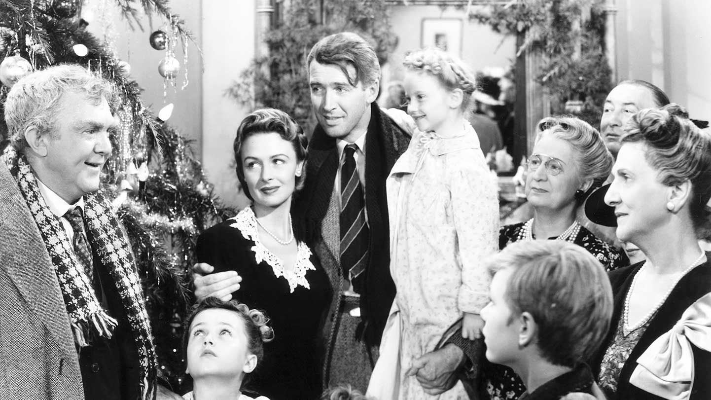 """Thomas Mitchell, Donna Reed, James Stewart, Karolyn Grimes Wilkerson, and Beulah Bondi in """"It's a Wonderful Life."""""""