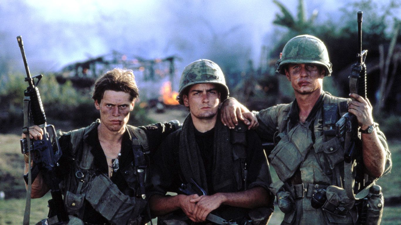 "Willem Dafoe, Charlie Sheen, Tom Berenger in ""Platoon."""