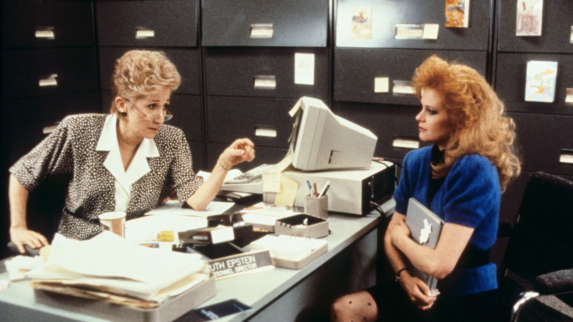 WORKING GIRL, from left: Olympia Dukakis, Joan Cusack, 1988.