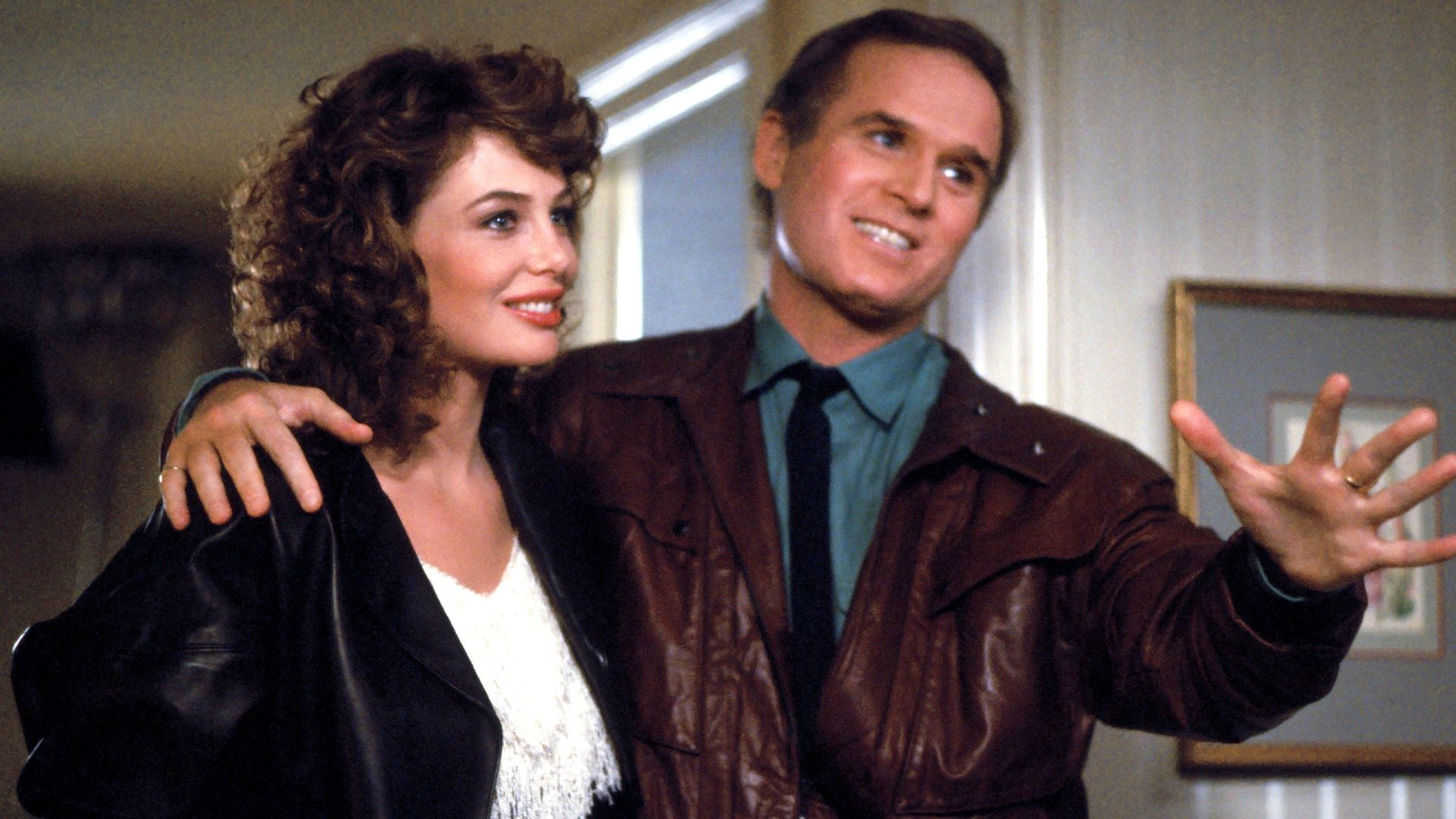 """Kelly LeBrock, Charles Grodin in """"The Woman in Red."""""""