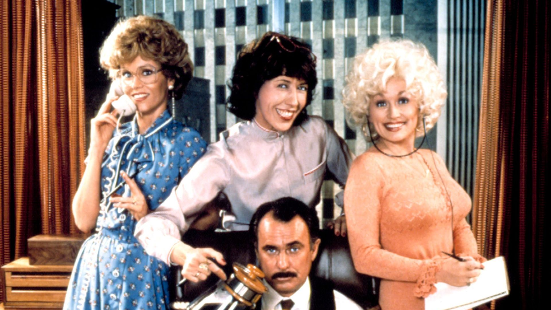 """Jane Fonda, Lily Tomlin, Dolly Parton, Dabney Coleman in promotional art for """"9 to 5."""""""