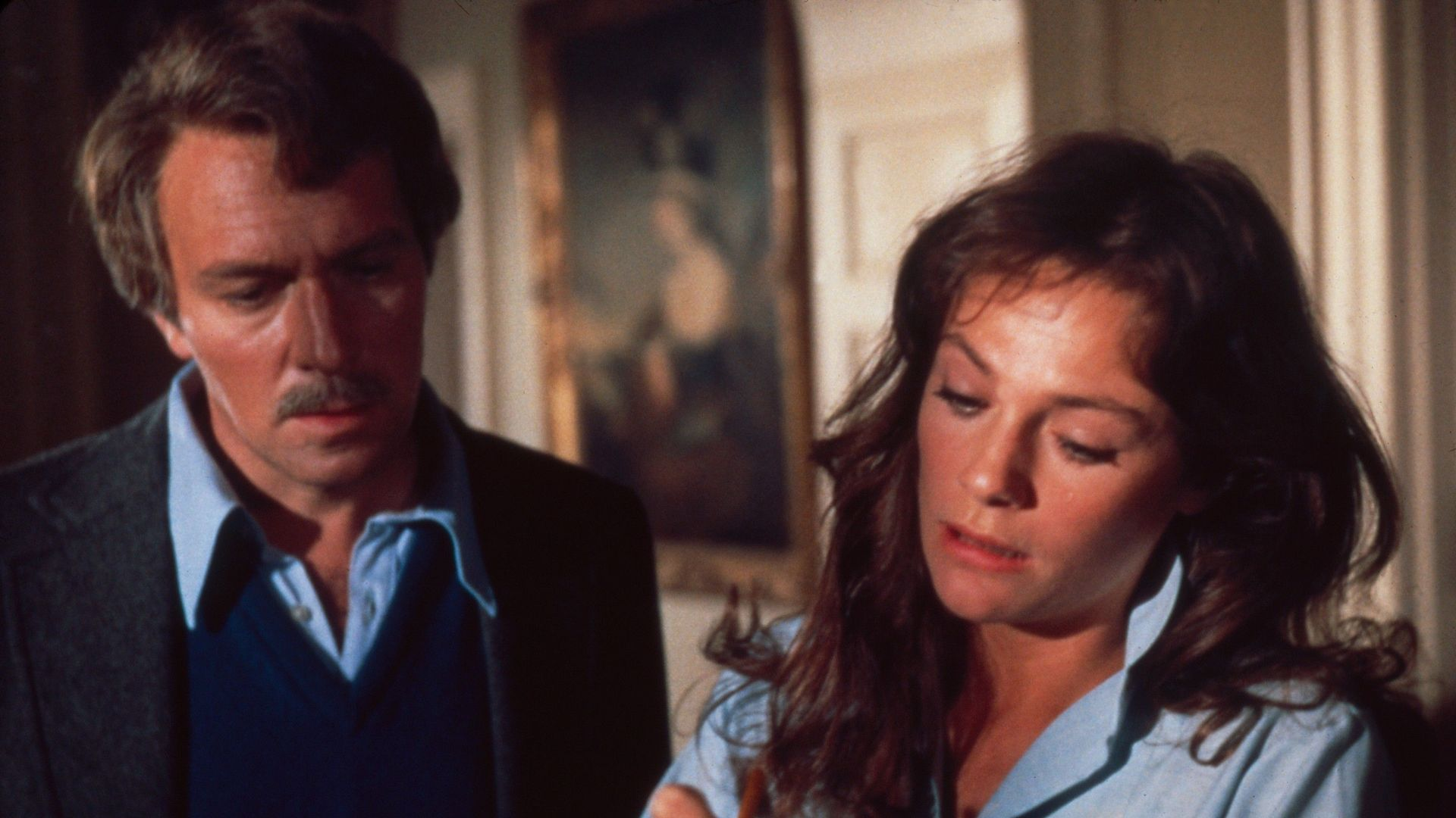 THE SPIRAL STAIRCASE, from left: Christopher Plummer, Jacqueline Bisset, 1975.