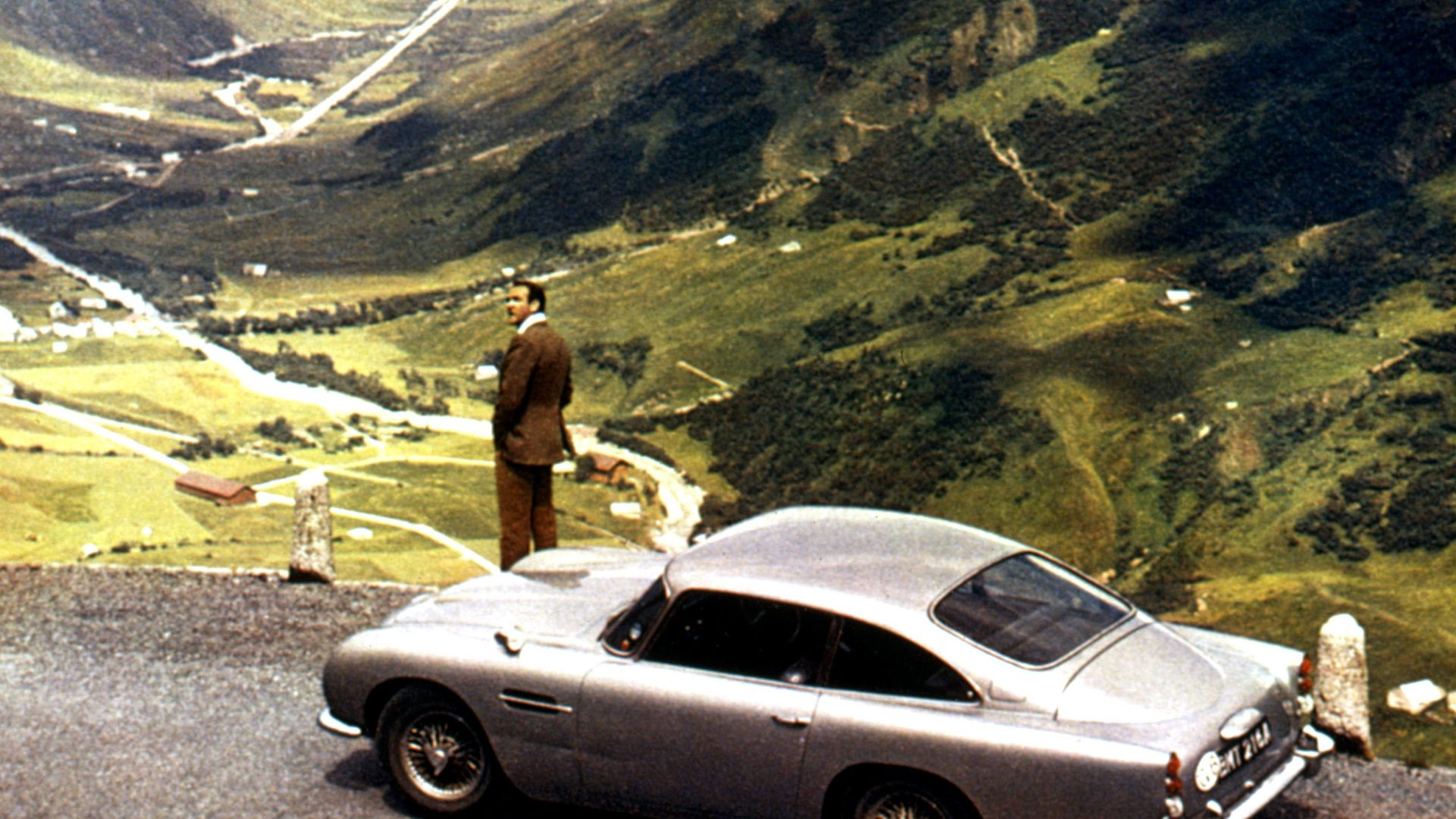 """Sean Connery and the Aston Martin DB5 from """"Goldfinger."""""""