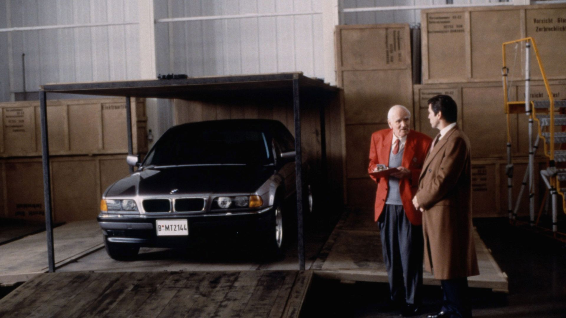 """Desmond Llewelyn, Pierce Brosnan with the BMW 750iL in """"Tomorrow Never Dies."""""""