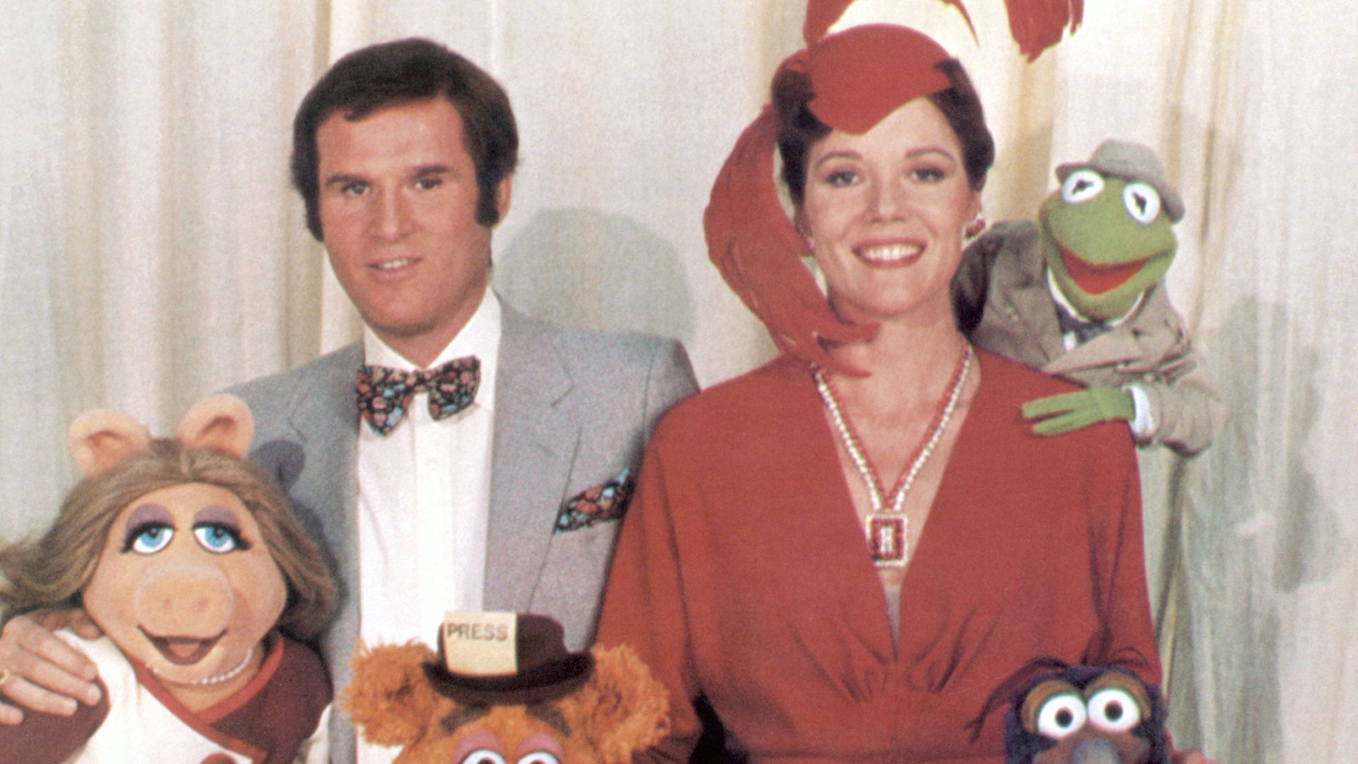 """Charles Grodin, Diana Rigg and the Muppets in """"The Great Muppet Caper."""""""