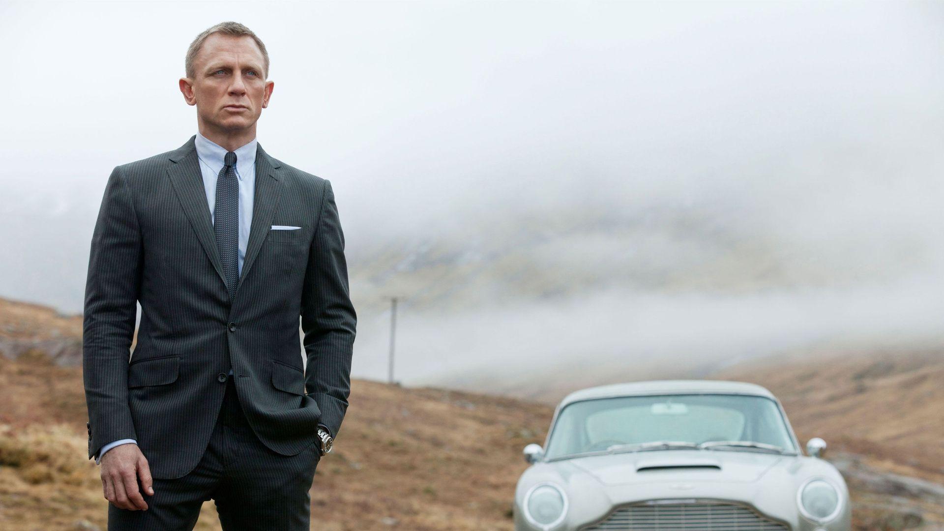 "Daniel Craig and the classic Aston Martin DB5 in ""Skyfall."""