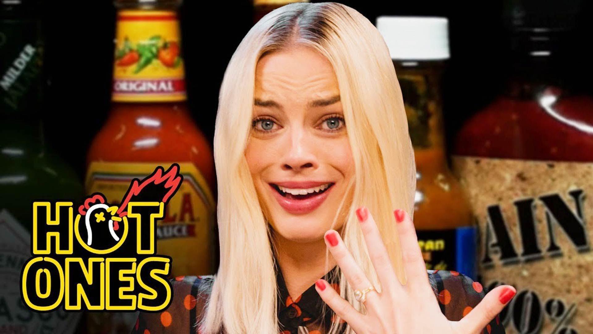 margot robbie burns her lips on hot ones