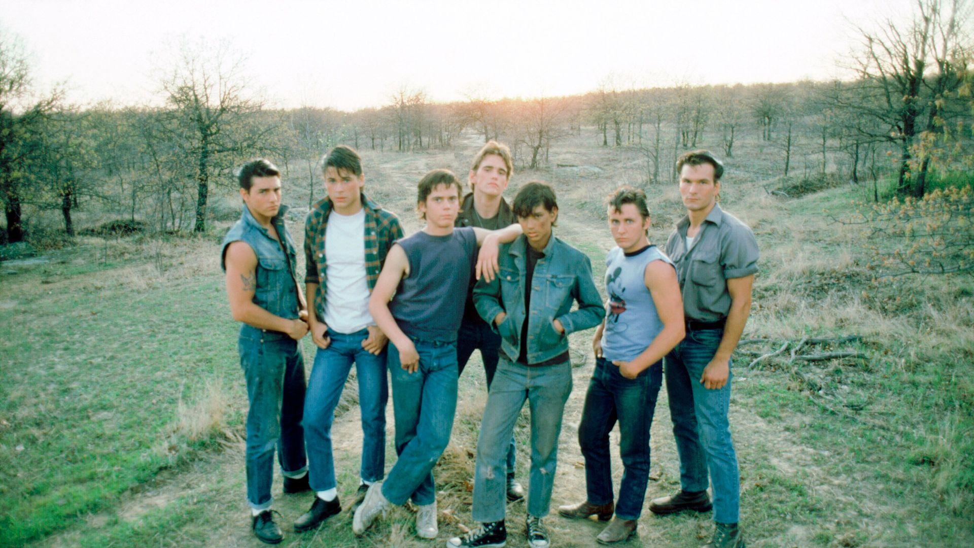 "Tom Cruise, Rob Lowe, C. Thomas Howell, Matt Dillon, Ralph Macchio, Emilio Estevez, and Patrick Swayze in ""The Outsiders."""