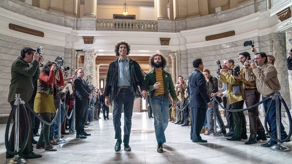 """Sacha Baron Cohen and Jeremy Strong in """"The Trial of the Chicago 7."""""""