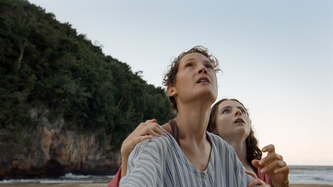 """Box Office - Vicky Krieps and Thomasin McKenzie in """"Old."""""""